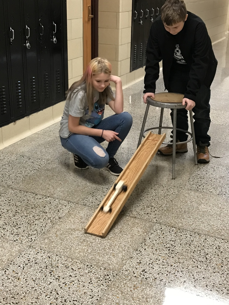 "Testing ""dragsters"" made in shop class"