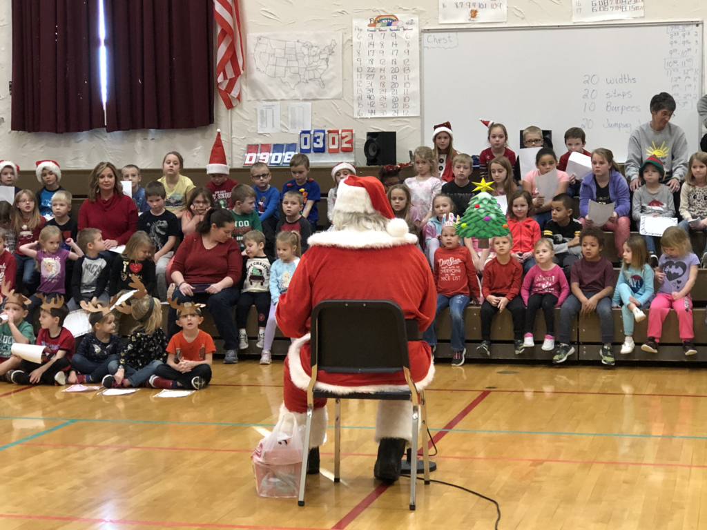 UPK-2nd Graders enjoying a visit from Santa
